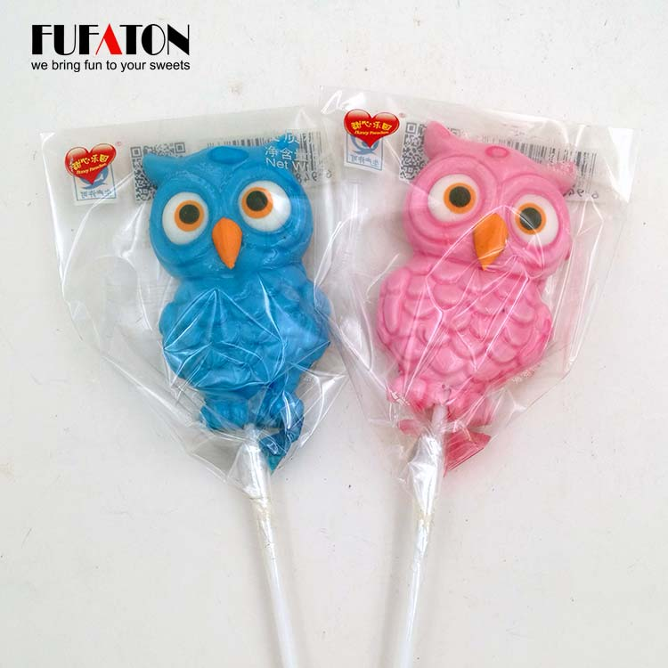 Owl shaped candy lollipop with hand decoration